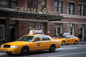 A photo of taxis in front of Chelsea Market, NYC.