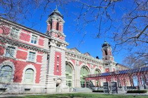 Photo of New York City Ellis Island Great Hall with blue clear sky